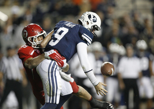 Trent Nelson | The Salt Lake Tribune  Utes linebacker Trevor Reilly (49) causes BYU quarterback Jake Heaps (9) to fumble during BYU's game against Utah at Lavell Edwards Stadium in Provo, Utah September 17, 2011.
