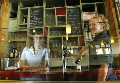 Steve Griffin / Tribune file photo     In 2008, Stella Grill bartender Taylor Pape, right, makes a drink as manager Erin O'Conner is reflected in a clear glass divider, which was allowed under previous Utah liquor laws.