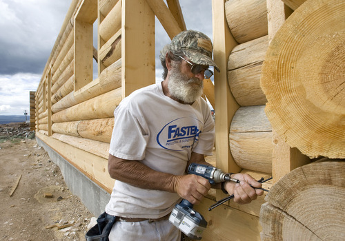 Al Hartmann  |  The Salt Lake Tribune Carpenter Duane Platt works on a log home at Thousand Lake Lumber in Lyman.  The company works with the U.S. Forest Service in timber salvage sales.