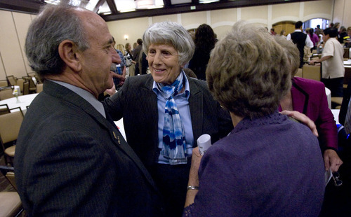 Al Hartmann  |  The Salt Lake Tribune Homelessness advocate Pamela Atkinson, center, greets Price Mayor Joe Piccolo, left, and Midvale Mayor Joann Seghin at the Utah Homeless Summit in Salt Lake City on Wednesday.