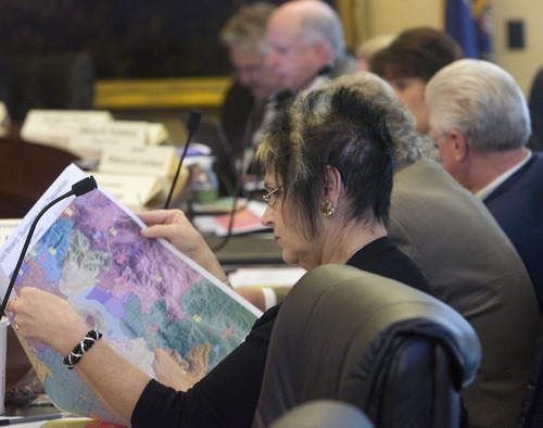 Al Hartmann  |  The Salt Lake Tribune  Rep. Merlynn Newbold, R-South Jordan, a member of the Legislature's Redistricting Committee looks over maps during Tuesday's meeting.