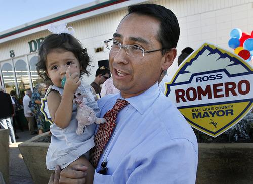 Scott Sommerdorf     The Salt Lake Tribune              Utah State Senator Ross Romero holds his 17 month old daughter, Marcella, prior to announcing his intent to run for Salt Lake County Mayor at the Mediterranean Market on State Street in Salt Lake City on Thursday.