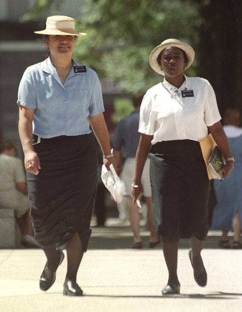 LDS missionaries Sister Lauifi, left, from San Diego, and Sister Kallon, from West Aftrica, walk on Salt Lake City's Temple Square.    photo by Rick Egan. 07/13/2000