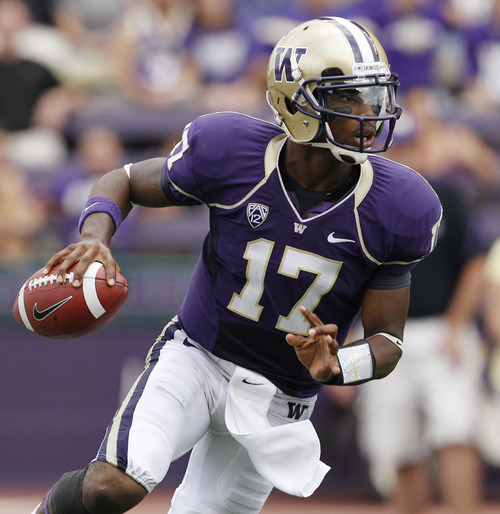 Washington quarterback Keith Price scrambles against California in the second half of an NCAA college football game, Saturday, Sept. 24, 2011, in Seattle. Washington won 31-23. Price threw for 292 yards and three touchdowns. (AP Photo/Elaine Thompson)