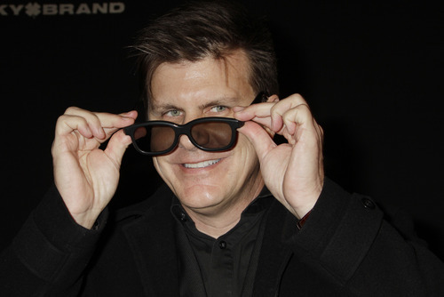 In this Feb. 6, 2010 file photo, Michael Lewis, CEO of RealD motion pictures 3-D glasses, shows a pair of the 3-D glasses at the Santa Barbara International Film Festival in Santa Barbara, Calif. Sony Corp.'s movie studio will save millions of dollars per movie after it told theater owners it will stop paying for 3-D glasses next May. But moviegoers could end up footing the bill. (AP Photo/Michael A. Mariant, File)