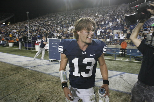 Rick Egan  | The Salt Lake Tribune   TV camera's follow Brigham Young Cougars quarterback Riley Nelson (13)after the game, as BYU defeated Utah State, 27-24 in Provo, Friday, September 30, 2011.