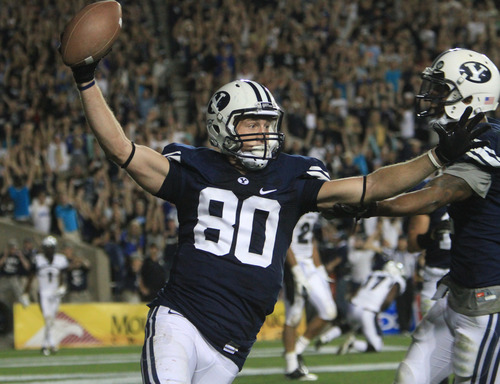 Rick Egan  | The Salt Lake Tribune   Brigham Young Cougars tight end Marcus Mathews (80) celebrates the winning touchdown as BYU defeated Utah State, 27-24 on this touchdown pass with 11 seconds left in the game,  in Provo, Friday, September 30, 2011.