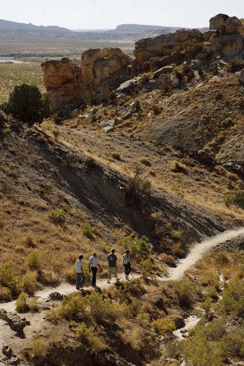 Trent Nelson  |  The Salt Lake Tribune The Horsfall family, on vacation from Australia, hiking the Fossil Discovery Trail at Dinosaur National Monument in Utah, Thursday, September 29, 2011.