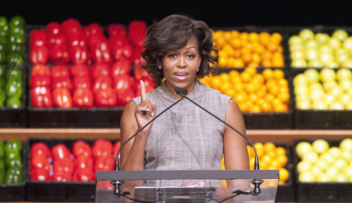 In this Jan. 20, 2011 file photo, first lady Michelle Obama takes part in Wal-Mart's announcement of a comprehensive effort to provide healthier and more affordable food choices to their customers, in Washington. (AP Photo/Cliff Owen, File)
