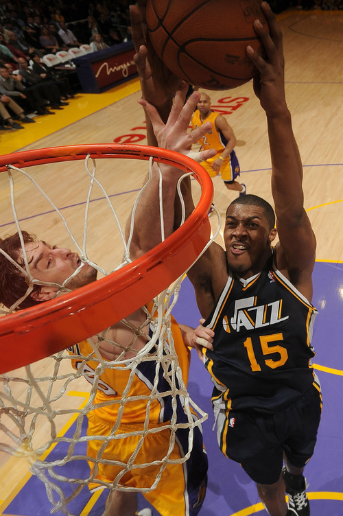 LOS ANGELES, CA - APRIL 5:  Derrick Favors #15 of the Utah Jazz goes up for a shot against Pau Gasol #16 of the Los Angeles Lakers during their game at Staples Center on April 5, 2011 in Los Angeles, California. NOTE TO USER: User expressly acknowledges and agrees that, by downloading and/or using this Photograph, user is consenting to the terms and conditions of the Getty Images License Agreement. Mandatory Copyright Notice: Copyright 2011 NBAE (Photo by Noah Graham/NBAE via Getty Images)