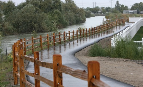 Steve Griffin  |  The Salt Lake Tribune A recreational trail and new vegetation, protected from beavers with a metal fence, flank the east side of the Jordan River in Midvale, part of a $1.1 million effort to revitalize the riparian corridor west of a former Superfund slag site.