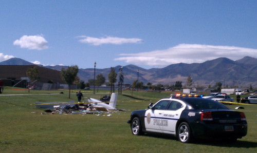 Cimaron Neugebauer  |  The Salt Lake Tribune West Jordan police investigate a single-engine homemade plane crash Tuesday. One man died at the scene and another was critically injured.