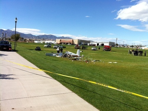 Steve Griffin | The Salt Lake Tribune West Jordan police investigate a single-engine homemade plane crash Tuesday, Oct. 4, 2011. One man died at the scene and another was critically injured.