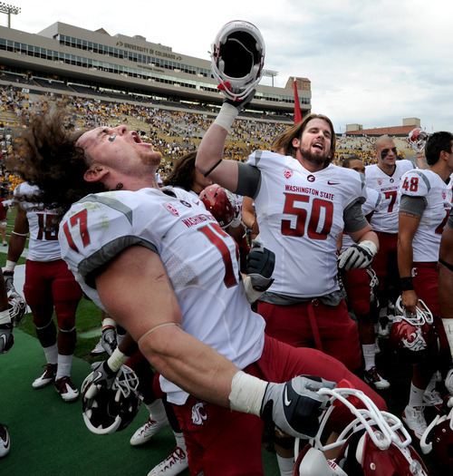 Washington State's Alex Hoffman-Ellis (17) and  Taylor Meighan, bcelebrate the 31-27 win over Colorado in an NCAA college football game, Saturday, Oct. 1, 2001, at Folsom Field in Boulder, Colo. (AP Photo/The Daily Camera, Cliff Grassmick) NO SALES