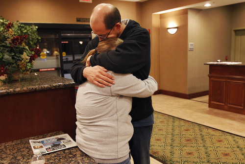 Deborah Bradley, left, and Jeremy Irwin embrace while in the lobby of an Hampton Inn hotel in Kansas City, Mo., Friday, Oct. 7, 2011. Bradley said in an interview Friday that she took a polygraph earlier this week after her baby, Lisa Irwin, disappeared from their Kansas City home. Bradley says police told her she failed the test. Lisa's father, Jeremy Irwin, said he has offered to take a lie detector test, but police said he did not have to. (AP Photo/Orlin Wagner)