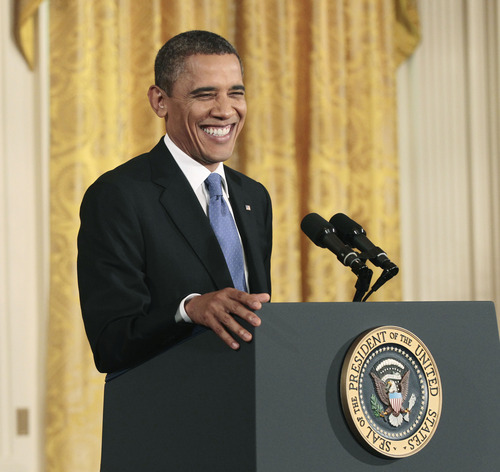 President Barack Obama smiles during his news conference in the East Room of the White House in Washington, Thursday, Oct., 6, 2011. (AP Photo/Pablo Martinez Monsivais)