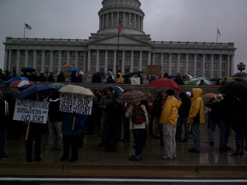 Leah Hogsten  |  The Salt Lake Tribune Occupy SLC supporters brave rain and cold as they gather on Thursday near the state Capitol.