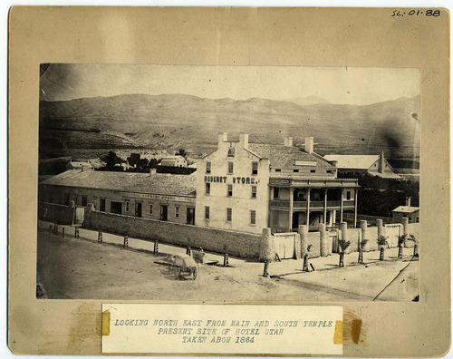 Tribune file photo  This 1864 photo shows the Deseret News offices in a building that also housed the Deseret Store and LDS Tithing Office. It is now the site of the Joseph Smith Memorial Building.