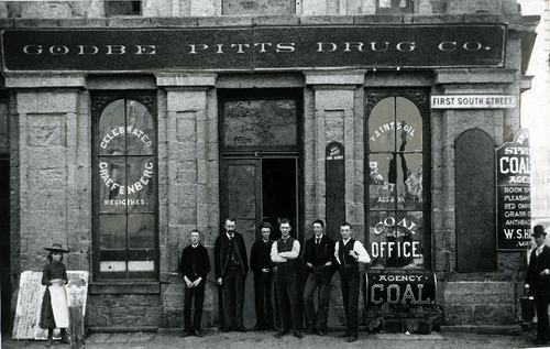 Tribune file photo  This undated photo shows a group of men and a young girl outside the Godbe Pitts Drug Company at 100 South Main Street in Salt Lake City.