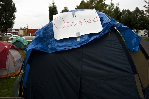 Chris Detrick  |  The Salt Lake Tribune An Occupy SLC participant's tent at Pioneer Park Friday October 7, 2011. The group opposes corporate greed and feels the government is out of touch with the people. They claim to be the 99 percent that has no voice.