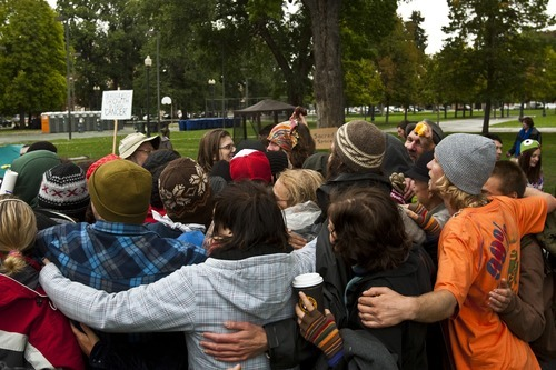 Chris Detrick  |  The Salt Lake Tribune Occupy SLC participants have a group hug at Pioneer Park on Friday, Oct. 7, 2011. The group opposes corporate greed and feels the government is out of touch with the people. They claim to be the 99 percent that has no voice.