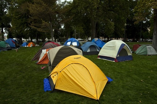 Chris Detrick  |  The Salt Lake Tribune Occupy SLC tents at Pioneer Park Friday October 7, 2011. The group opposes corporate greed and feels the government is out of touch with the people. They claim to be the 99 percent that has no voice.