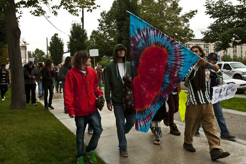 Chris Detrick  |  The Salt Lake Tribune Occupy SLC participants rally at Pioneer Park on Friday. The group opposes corporate greed and feels the government is out of touch with the people. They claim to be the 99 percent that has no voice.