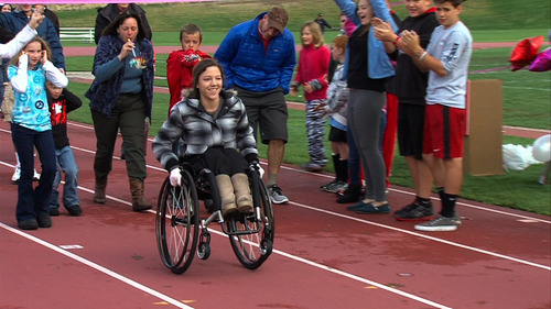 Courtesy KUTV-2 East High School student Eliza McIntosh broke the Guinness World Record Saturday for the longest continuous wheelie in a wheelchair, going 12.45 miles in three hours and 51 minutes.