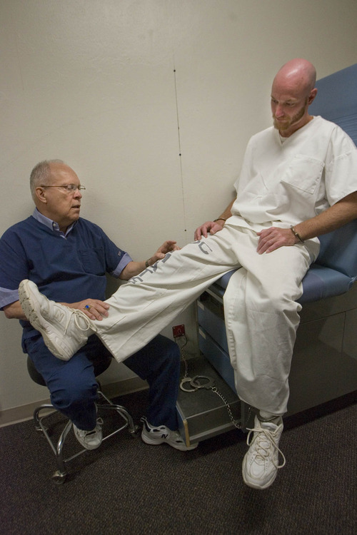 Paul Fraughton | The Salt Lake Tribune Bohn Bales, the physical therapist at the Utah State Prison  examines the knee of prisoner Burns Tomlinson.   Wednesday, October 5, 2011
