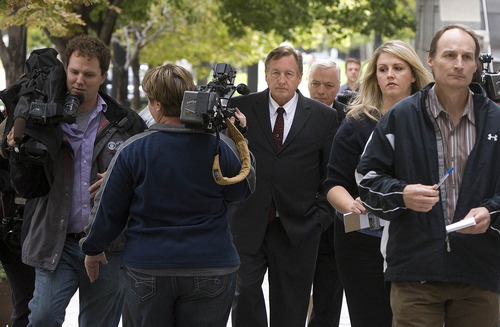 Paul Fraughton | The Salt Lake Tribune  Bugman Pest and Lawn owner Ray Wilson pleaded guilty on behalf of his company Tuesday to breaking federal pesticide laws in a case tied to the deaths last year of two Layton girls. Here, he leaves the federal courthouse in Salt Lake City surrounded by media cameras and reporters.