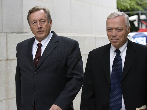 Paul Fraughton | The Salt Lake Tribune Owner of Bugman Pest and Lawn, Ray Wilson, left, with his lawyer, Dennis James, walks into federal court in Salt Lake City on Tuesday, where he entered a guilty plea on behalf of his company to breaking federal pesticide laws in a case tied to the deaths last year of two Layton girls.