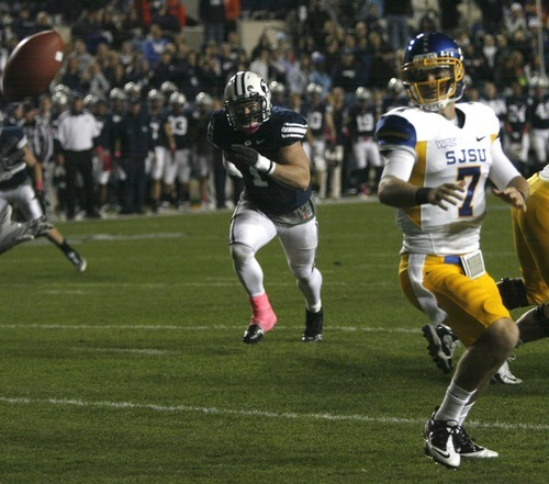Rick Egan  | The Salt Lake Tribune   San Jose State Spartans quarterback Matt Faulkner (7) watches the hiked ball sail past him out of the endzone for a safety, in football action, BYU vs. San Jose State, at Lavell Edwards stadium, Saturday, October 8, 2011.