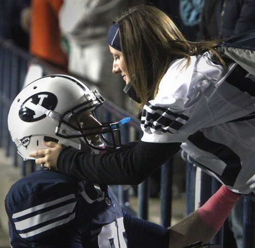 Rick Egan  | The Salt Lake Tribune   Marybeth Small greets Brigham Young Cougars tight end Matthew Edwards (89) after the BYU vs. San Jose State, football game at Lavell Edwards stadium, Saturday, October 8, 2011.