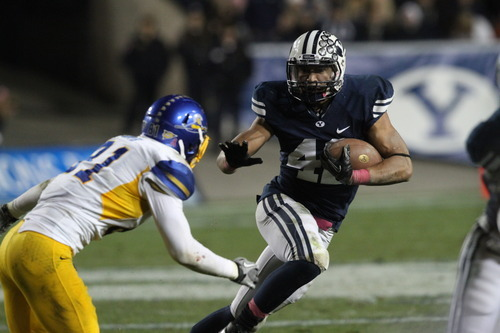 Rick Egan  | The Salt Lake Tribune   Brigham Young Cougars running back Michael Alisa (42) runs past San Jose State Spartans safety James Orth (81), in football action, BYU vs. San Jose State, at Lavell Edwards stadium, Saturday, October 8, 2011.