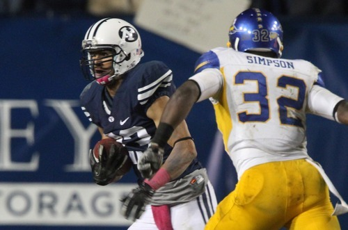 Rick Egan  | The Salt Lake Tribune   Brigham Young Cougars defensive back Travis Uale (23)  runs from San Jose State Spartans running back Jason Simpson (32) after intercepting a pass for BYU, in football action, BYU vs. San Jose State, at Lavell Edwards stadium, Saturday, October 8, 2011.