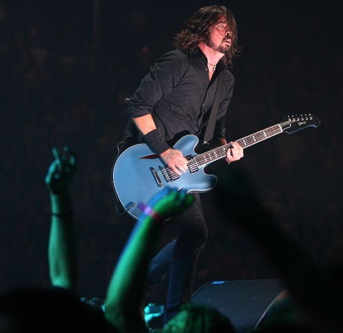 Steve Griffin  |  The Salt Lake Tribune   Foo Fighters lead vocalist Dave Grohl plays to the crowd during a concert at the Maverik Center in West Valley City on Tuesday, Oct. 11, 2011.