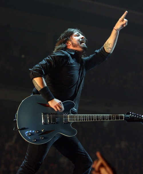 Steve Griffin  |  The Salt Lake Tribune   Foo Fighters lead vocalist Dave Grohl gets the crowd into it during a concert at the Maverik Center in West Valley City on Tuesday, Oct. 11, 2011.