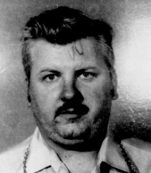 This 1978 file photo shows serial killer John Wayne Gacy. More than 30 years after a collection of decaying bodies was found beneath John Wayne Gacy's house, detectives have secretly exhumed the remains of eight young men who were never identified in the hopes that DNA testing can solve the last mystery of one of the nation's most gruesome serial killers.  (AP Photo/File)