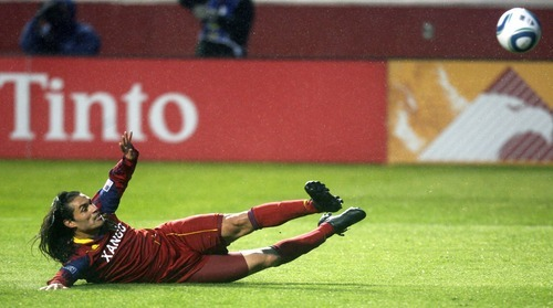 Steve Griffin  |  The Salt Lake Tribune   Real Salt Lake's Fabian Espindola  shoots the ball at the goal as he slides across the wet turf during first half action in the Real Salt Lake versus Colorado Rapids at Rio Tinto Stadium in Sandy, Utah Wednesday, April 13, 2011.