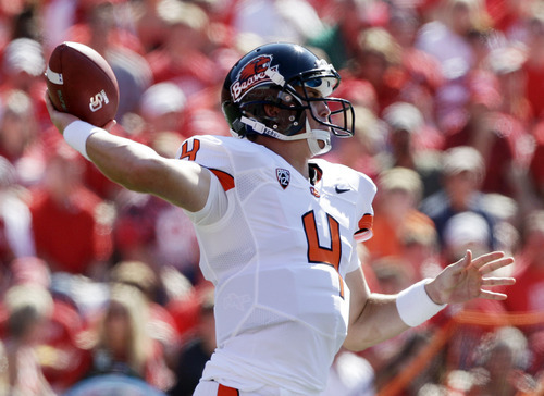 Oregon State's Sean Mannion throws during the first half of an NCAA college football game against Wisconsin, Saturday, Sept. 10, 2011, in Madison, Wis. (AP Photo/Morry Gash)