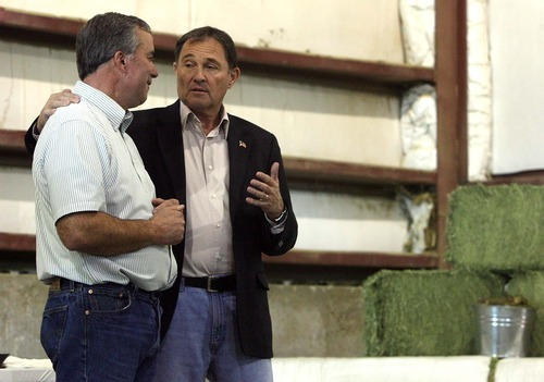 Leah Hogsten | The Salt Lake Tribune Utah Governor Gary Herbert (left) met with Ephraim business owner Tom Bailey (right) and other county and city leaders to discuss how growth of jobs in the county Thursday, October 13 2011. Bailey's hay cubing exports 95% of their compressed hay to Asia and the Middle East, taking in some 45,000 tons of hay from 562 farms, averaging $45million in yearly sales.