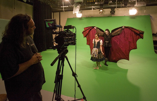 Paul Fraughton | The Salt Lake Tribune Beau Pearson, dancing the role of Dracula, spreads his cape behind Arolyn Williams for the camera at a recent photo shoot in  the KSL studios for a commercial for Ballet West's new production of