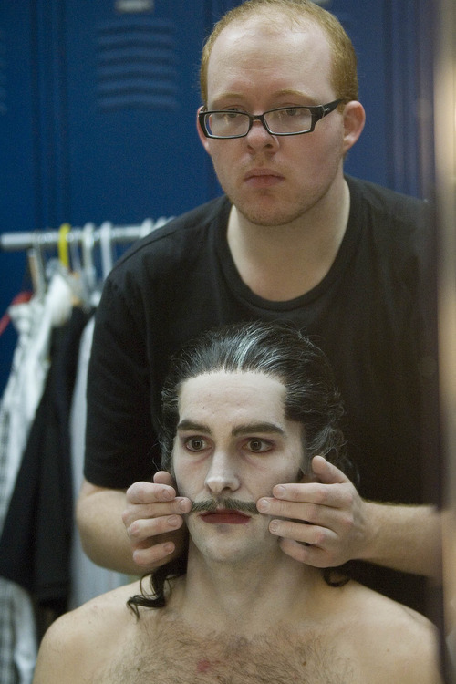 Paul Fraughton | The Salt Lake Tribune Makeup artist Yancey Quick checks on Beau Pearson, who plays Dracula,  prior to a recent photo shoot at the KSL studios for a commercial for Ballet West's new production of