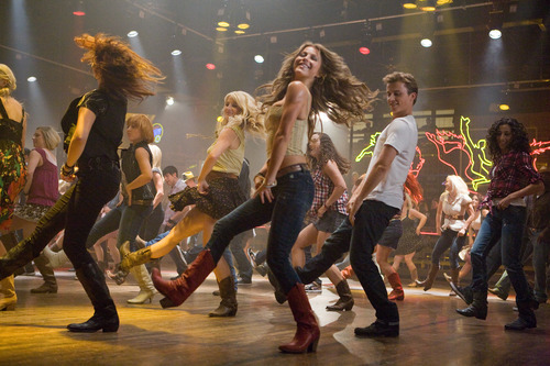 In this image released by Paramount Pictures, Julianne Hough, center, and Kenny Wormald are shown in a scene from