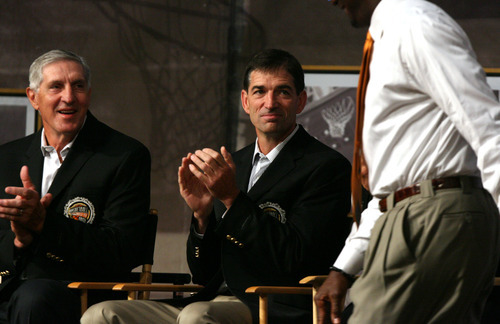 Tribune file photo  Jerry Sloan, left, and John Stockton applaud Michael Jordan during the Hall of Fame press conference in 2009. Sloan and Stockton were inducted.