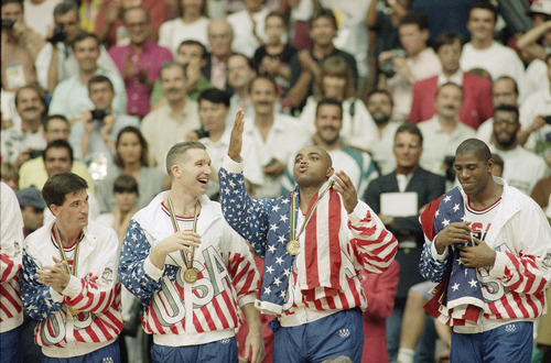 Tribune file photo  From left the USA's John Stockton, Chris Mullin, and Charles Barkley rejoice with their gold medals after beating Croatia, 117-85 in Olympics basketball in Barcelona Saturday, Aug. 8, 1992. The USA beat Croatia 117-85 to win the gold medal.