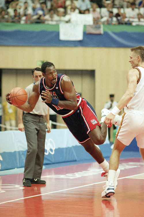 Tribune file photo  USA's Karl Malone looks to pass as he keeps the ball in play during their preliminary basketball game with Germany at the XXV Summer Olympics in Barcelona, Wednesday night, July 29, 1992.