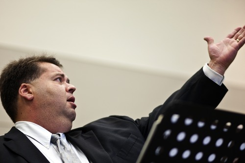Chris Detrick  |  The Salt Lake Tribune Mormon Tabernacle Choir member Laurent Neu sings at the 22nd Annual Families and Professionals Conference sponsored by the Brain Injury Association of Utah at the South Towne Expo Center on Thursday Oct. 13, 2011.