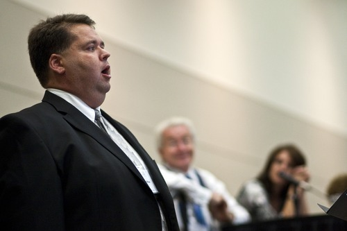Chris Detrick  |  The Salt Lake Tribune Mormon Tabernacle Choir member Laurent Neu sings at the 22nd Annual Families and Professionals Conference sponsored by the Brain Injury Association of Utah at the South Towne Expo Center on Thursday, Oct. 13, 2011.