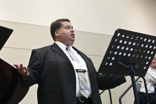 Chris Detrick  |  The Salt Lake Tribune Mormon Tabernacle Choir member Laurent Neu sings at the 22nd Annual Families and Professionals Conference sponsored by the Brain Injury Association of Utah at the South Towne Expo Center Thursday October 13, 2011.